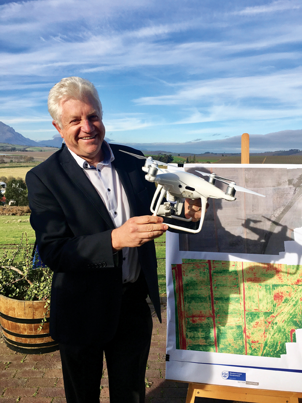 Western Cape Minister of Economic Opportunities, Alan Win­- de, yesterday at a de­monstration of drone technology at Elsenburg. The drone used in the demonstration, a phantom 4 pro, has a 20 mega­pixel ca­me­ra sensor and a range of 7 km, allowing agri-technicians to achieve high resolution imagery and wide area monitoring.