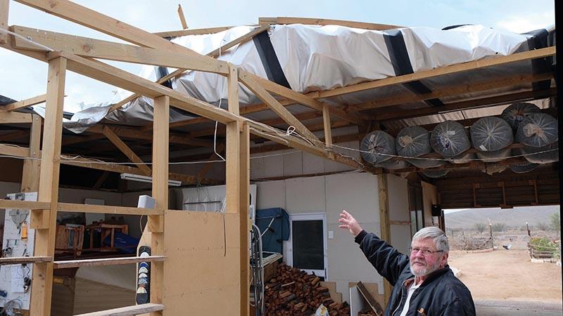 Joseph van der Colf (63) wys die dak van sy kinders se huis in Volmoed wat afgewaai het. Foto: Schalk le Roux