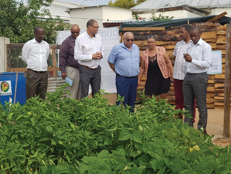 Minister Fritz and Mayor Sylvester visits the food garden behind the shelter.
