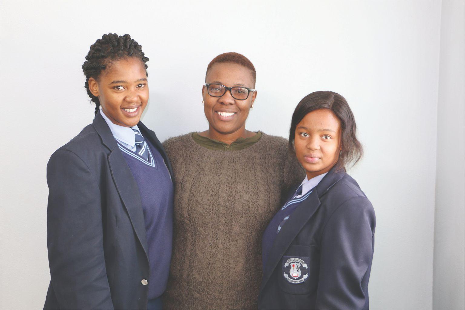 Marissa Faku (left) and Amiliselwe Boto with their economics teacher, Pamela Mapongwana.  Photo: Angelique Erasmus